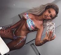 Georgina Gentle in a bikini taking a selfie