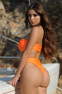 Demi Rose Mawby in a bikini - ass