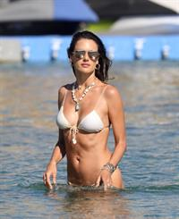 Alessandra Ambrosio ass and cleavage in a sexy thong bikini at the beach seen by paparazzi.