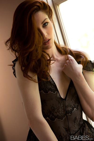 Stoya is simply irresistible in her black lingerie, it fits perfectly her pale skin and red hair. Here she strips and slowly reveal her perfect body in the most sensual way