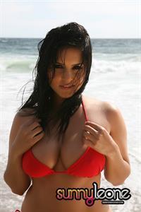 Sunny Leone wearing a red bikini