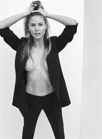 Heidi Klum topless braless boobs in an open jacket showing off her nude tits and abs.