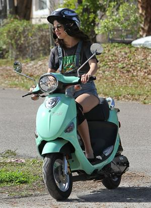 Selena Gomez rides a scooter on set of spring breakers on February 29, 2012